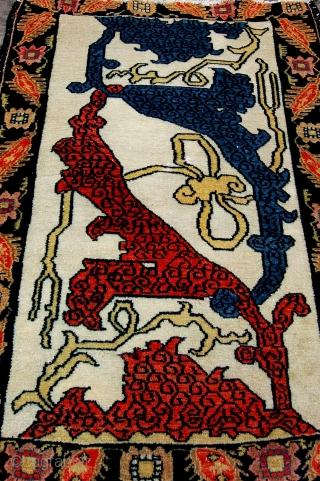 Rare antique Kurdish Senneh mat. Late 19th.c. 96 x 59cm. Losses to the top border. Beautiful white ground garrus design.