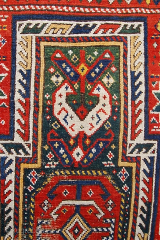 Antique Caucasian keyhole design rug. Probably Genje. Late 19 th. 238 x 118cm. Untouched. A few spots of wear to the field.  Lovely colours and original macrame end finishes.