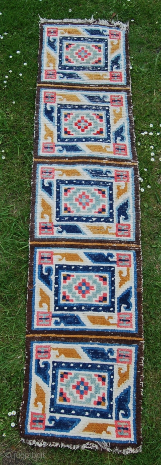 Small Tibetan runner. 199 x 46cm. All wool foundation. Probably early 20th century. A charming rug and a very useful size at a low price.