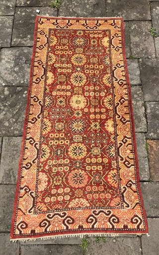 Antique Khotan rug in remarkable condition. Good pile, no repairs and original ends and sides.Early 19th century. 9 x 4 feet. [aprox. 274 x 122cm]