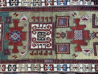 Lovely old karachop kazak. Super green ground. Has some old repairs and has edge losses. Approx 3x1.3m