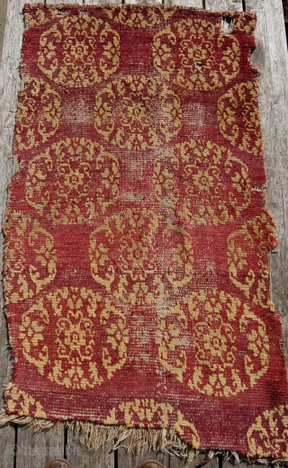Early tibetan khaden rug. 19th century. In compromised condition but priced accordingly. Design based on chinese textiles.