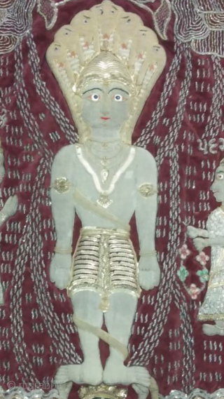 Real silver and gold foil work of Jain temple hanging hand embroidered from Gujarat India the size of the hanging is 23 inches X 37 inches.