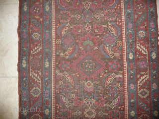 an early north-west persian long rug, possibly kurdish, with a very unusual colour palette, all natural with different purples and light indigo abrash. ends and selvedge partially worn but more or less  ...