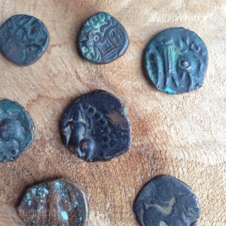 10 coins from the ancient silk road dating approximately from 3th to 6th century depicting talisman, animals, warriors, script, pearl roundel like design etc...  exchange possible, low rate..