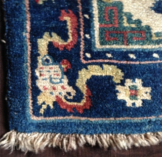 late 19th century tibetan white ground saddle rug with very nice all natural colors,. very good condition,super fine wool and very tight knotting. abrashed light green center and deeper green corners..