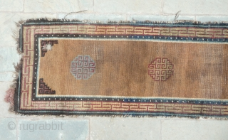 beautiful early tibetan monastic bench cover fragment with floating guls on an empty brown space. lovely patinated old colors, the black color in places is a natural brown overdyed with dark indigo.super  ...