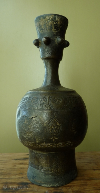 early islamic period bronze rose-water bottle, eastern iran, 10-12th century. richly decorated and with script. the bottom is missing. it has been purchased in afghanistan in the early 20th century. for similar  ...
