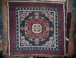 TIBET : early mandala square, most probably lama single seat, not a fragment from a bench cover, wonderfuly aged colors, including 2 nice shapes of purple, the red is also worth of  ...