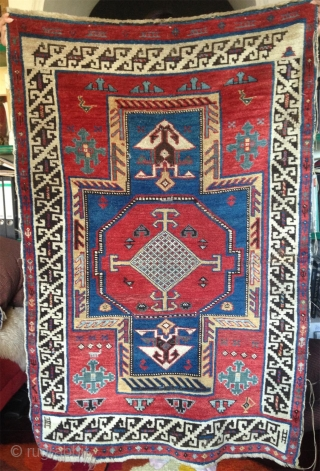 19th century small caucasian rug with bold  color contrast and unusual design details..