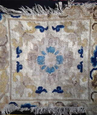 an around 300 years old ningxia mat which is not only worn.. it is also one of the best execution of this design group on a white ground which is not very  ...