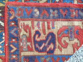 Early 19th c. SaujBulagh rug fragment composed of assembled borders. Cool!