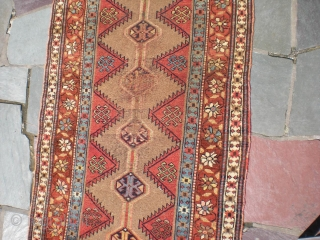 "Bakhshayesh long rug, 8' 2"" X 3' 3"", later 19th century, wool on wool. Heavy wear to foundation limited to central area; sides have good even pile; middle field has low even  ..."