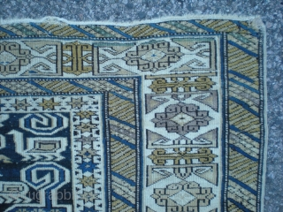 """Caucasian, Shirvan/Perpedil with ram's head and bird design elements. Circa 1900, mostly original (repaired slit at one end and a couple small/minor re-piled spots, shown in closeups). Size is 5' 5"""" x  ..."""