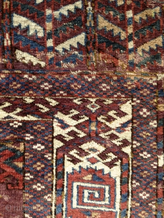 "Yomud ""Dyrnak"" main rug, 2nd half of 19th cent., 315X215cm, wool on wool, 9x3 dyrnak guls in beautiful variations of greens, blues, brick-reds, yellows and whites on a light brick red ground.  ..."