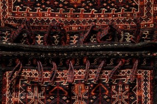 Bakhtiari saddle bag, 60x112cm, end of 19th century, Iran Beautiful hand knotted ends with high pile. Sewn together on the sides with finely spunned goat hair yarns. And all the black colors also made  ...