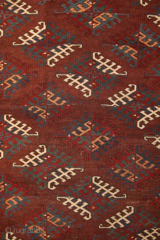 "Yomud ""Dyrnak"" main carpet, 310x170 cm, 19th cent., fantastic colors, different blues , greens, yellows.... unusual elem, opened, bold and graphic drawing, well balanced, spacious field, very fine weave, some unfolded  ..."