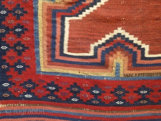 Afshar kilim, 2nd half of 19th century, 180X115cm. 3 rythmical diamonds on a brick-red ground, sorrounded by eye dazzler, rainbow-like saf-bordure. The main field repose the eyes between the vibtaring, multiple borders.  ...