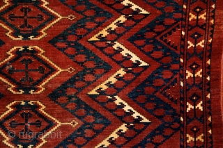 Ersari 'ikat' chuval, 19th century, 150x100 cm, almost intact condition, some small wear in the upper end otherwise full, meaty pile overall. 3 floating cross-medallions in a tremolous, deep field. Clear, archaic  ...