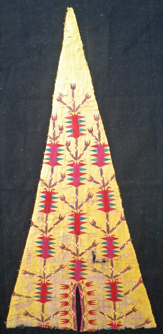 Sheer gold silk side section of a Tekke chirpy, 85 x 40 cms. Embroidery in silk, beautifully and spaciously drawn design with superb natural colours, foundation of coarsely woven cotton. Mounted on  ...