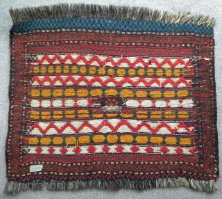 Fars province, perhaps Qashqai, bag face, 76 x 59 cms, goat hair warps, pile border with a pile section in the centre (star design), the remainder being weft faced weave using both  ...