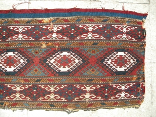 NWP sumak mafrash side panel with cloudbands, 101 x 47 cms, finely woven with excellent colours, wool and undyed cotton, floppy and light handle, areas of damage as apparent in images.