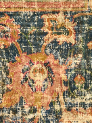 Border Fragment of a 17th century Isfahan or Indo-Isfahan Carpet. This fragment preserves a small portion of the red lac ground with a blue cloudband and floral ornament. A larger portion of  ...