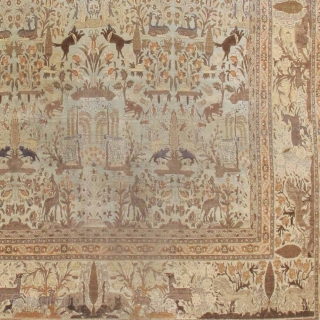 Tabriz carpets have always been known for their grandeur and elegance. This majestic antique Tabriz draws a field and border with a host of animal imagery. A traditional Persian garden scene, complete  ...