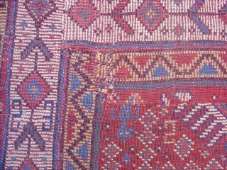 Kurd Rug, probably from Khorosan. Great wool and color with a regional adaptation of some familiar Kurdish drawing. Second Half of the 19th century (probably 3rd quarter). This piece has been cut  ...