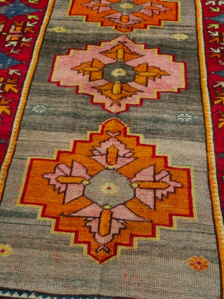 This is an authentic early 1900s all-wool Konya rug in Kazak design in brilliant colours defying age and use