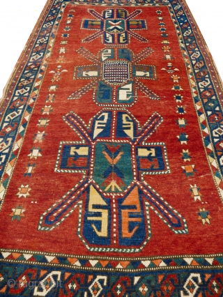 This is a spectacular collector's antique Caucasian Kazak rug dating to the second half of the 19th century (1860-1890) it features three different Seichour cruciform motifs referred to by western scholars as  ...