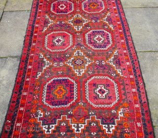 Beluch Salar Khani rug 6.5x3.1 feet Material:Wool on wool Manufacturing period:1950-1999 Country:Afghanistan Condition:Overall in good condition Rug professionally cleaned:Yes This is an authentic Afghan Beluch hand-knotted rug. It features two vertical rows of geometric medallions referred to by  ...