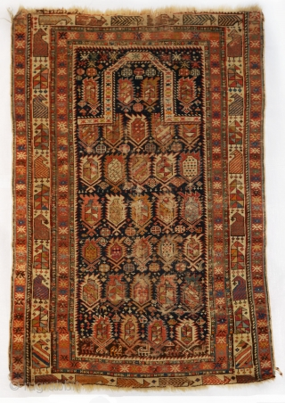 Turn of the century Shirvan Marasali with boteh all-over pattern inscribed into the classic Mihrabi design. Note the comb crowning the mihrab. A bit distressed but a lovely piece. Some 'hot orange',  ...