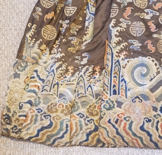 Tibetan Monastic Dance Robe Tailored in Tibet using a repurposed early 18th century Qing dynasty, Yongzheng period commemorative court robe. Woven rich brown silk satin brocaded with polychrome silk and gold wrapped threads  ...