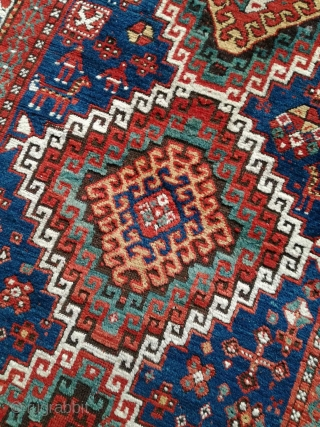 An antique Kazak rug. All natural dyes. 220/134 cm. Signs of use but good shape. All endings original. No repairs.