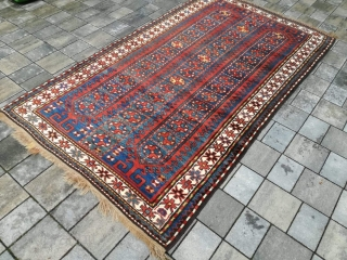 Old Kazak or Karabagh rug with 243/134 cm. Perfect condition with full pile.