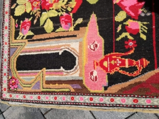 An old Karabagh rug with 200/135 cm. Good shape with little signs of use.