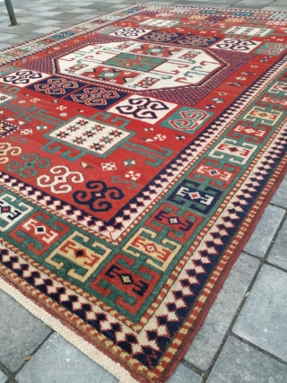 An antique Kazak Karachof with 200/148 cm. Great design with warm madder red, better than on the pics you see. All over original endings. No repairs. Good shape but a couple of  ...