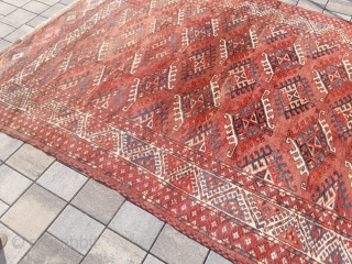 An old or antique Yomud Turkmen carpet with 354/200 cm. Good shape for its age with smallest repiles. Original endings on the long sides and kilim on one side.
