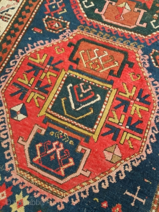 An antique Kazak rug with 225/140 cm in good shape for its age.