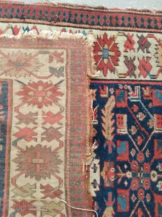 An antique Kurdish rug in as found condition. 310/110 cm.