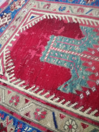 An antique Anatolian rug with 170/110 cm. Repiles and demages. Rare design.