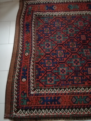 An antique Baluch with 218/135 cm. Good shape with few demages.