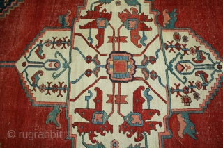 """A very decorative genuine antique Persian Serapi. It measures 11'-10"""" x 14'-10"""". The entire rug has a low even flat pile and with some minor wear but no foundation threads are visible.  ..."""