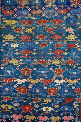 Kazak, Kaukasus, Kuba area, Chi-Chi, early 20th century.  Some old repairs. crispy.  Original sides.  253 x 115 Cm. 8.4 feet x 3.7 feet.  Scorpions on a blue field.