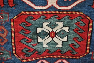 Kazak, Chaili, village in the neighbourhood of the Moghan area.  Very traditionally in the design. The red ground is rare. Mostly indigo blue.  Some light corroding in the black. A few minimal moth  ...