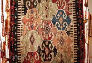 Rare Anatolian Kilim. Between Sivrihisar and Kütahya. S-W of Ankara.   Elibelinde figures. The old Goddess.  Dating back for several thousands years.  Pre Christian.  These figures with the notched 'wings' at the sides is  ...