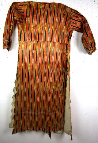 19th century silk Kaftan with ikat weaving.  Iran. In near mint condition.  With provenance, for the buyer only.  Gomes from a small museum and was on loan from a close relation of  ...