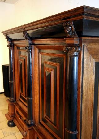 Fine Dutch 2nd half 17th century 'Kolommen kast'.  Ebony and oak. High 155 Cm. wide 174 Cm. Deep 66 Cm.  The doors are 8 Cm. thick. The key is 15 Cm long!.  Hidden  ...