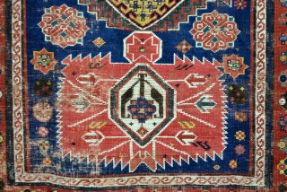 Iconic Shirvan, late 19th century. Mazdaism all over, the red medaillons are the winged God Farouvar of Mazda protecting the rug.  In the border on the white ground vure and fire toartch.  ...